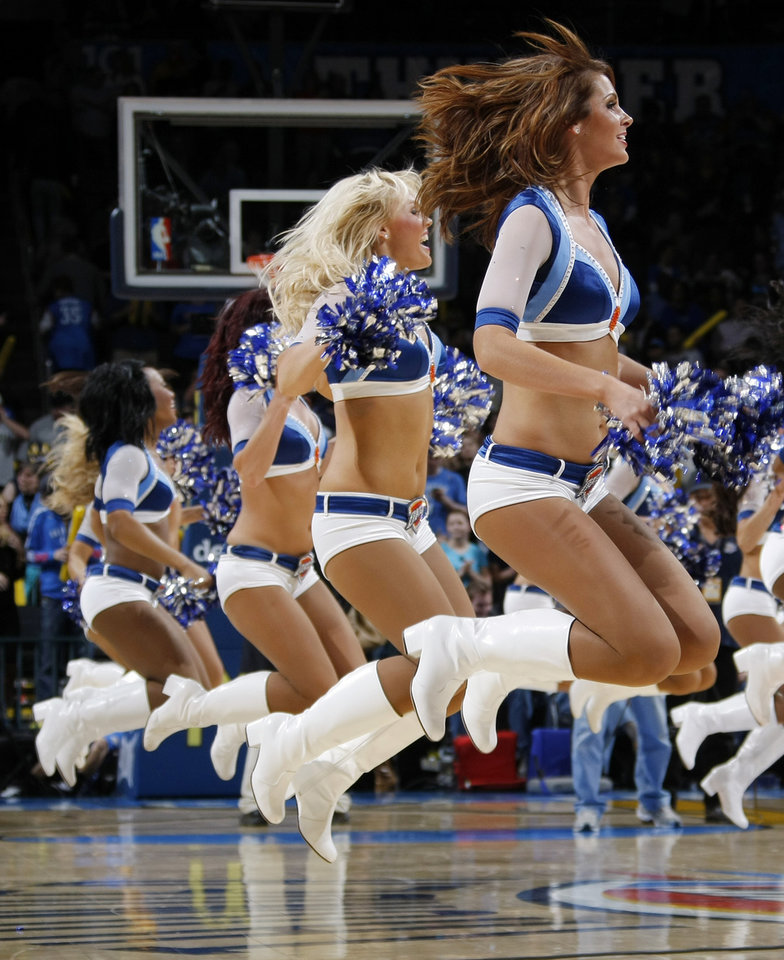 Photo - The Thunder Girls perform during the NBA basketball game between the Washington Wizards and the Oklahoma City Thunder at the Oklahoma City Arena in Oklahoma City, Friday, January 28, 2011. The Thunder won, 124-117, in double overtime. Photo by Nate Billings, The Oklahoman