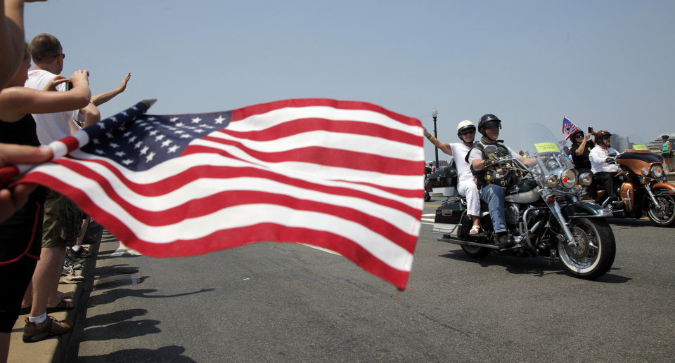 Photo -   Motorcycles drive past on Memorial Bridge during the annual Rolling Thunder parade ahead of Memorial Day in Washington, Sunday, May 27, 2012. (AP Photo/Charles Dharapak)