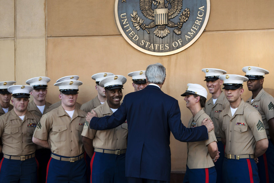Photo - U.S. Secretary of State John Kerry greets U.S. Marines as he arrives at the U.S. Embassy in Baghdad, Iraq, Monday, June 23, 2014. Kerry said the fate of Iraq may be decided over the next week and is largely dependent on whether its leaders meet a deadline for starting to build a new government. (AP Photo/Brendan Smialowski, Pool)