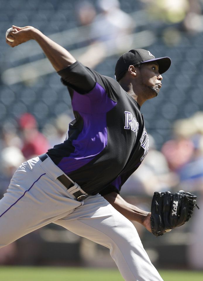 Photo - Colorado Rockies starting pitcher Juan Nicasio throws against the Kansas City Royals during the first inning in an exhibition spring training baseball game Tuesday, March 19, 2013, in Surprise, Ariz. (AP Photo/Gregory Bull)