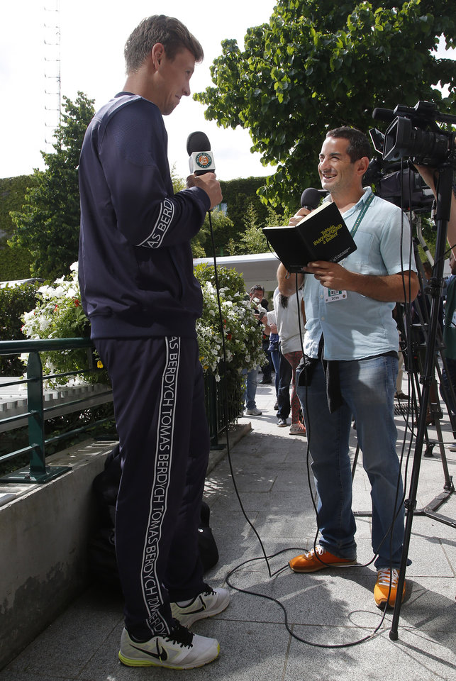 Photo - Tomas Berdych, left, of the Czech Republic,  answers reporters after the first round match of  the French Open tennis tournament at the Roland Garros stadium, in Paris, France, Sunday, May 25, 2014. (AP Photo/Michel Euler)