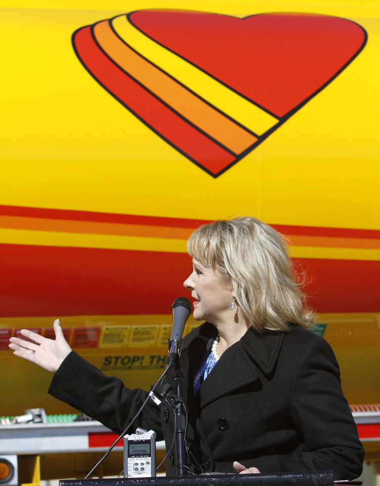 Photo - Gov. Mary Fallin speaks Monday during the opening of Love's Travel Stops first