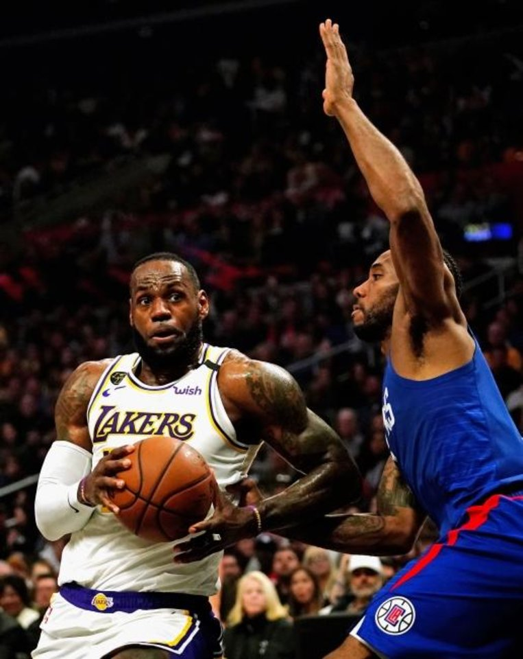 Photo -  Most projections have the Western Conference being decided by LeBron James' Lakers and Kawhi Leonard's Clippers. They face off at 8 p.m. Thursday in the NBA's restart in Florida. [Kirby Lee/USA TODAY Sports]