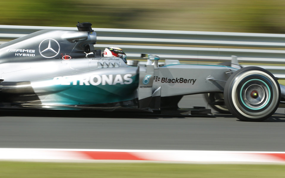 Photo - Mercedes driver Lewis Hamilton of Britain steers his car during the free practice session at the Hungarian Formula One Grand Prix in Budapest, Hungary, Friday, July 25, 2014. The Hungarian Formula One Grand Prix will be held on Sunday, July, 27, 2014. (AP Photo/Darko Bandic)
