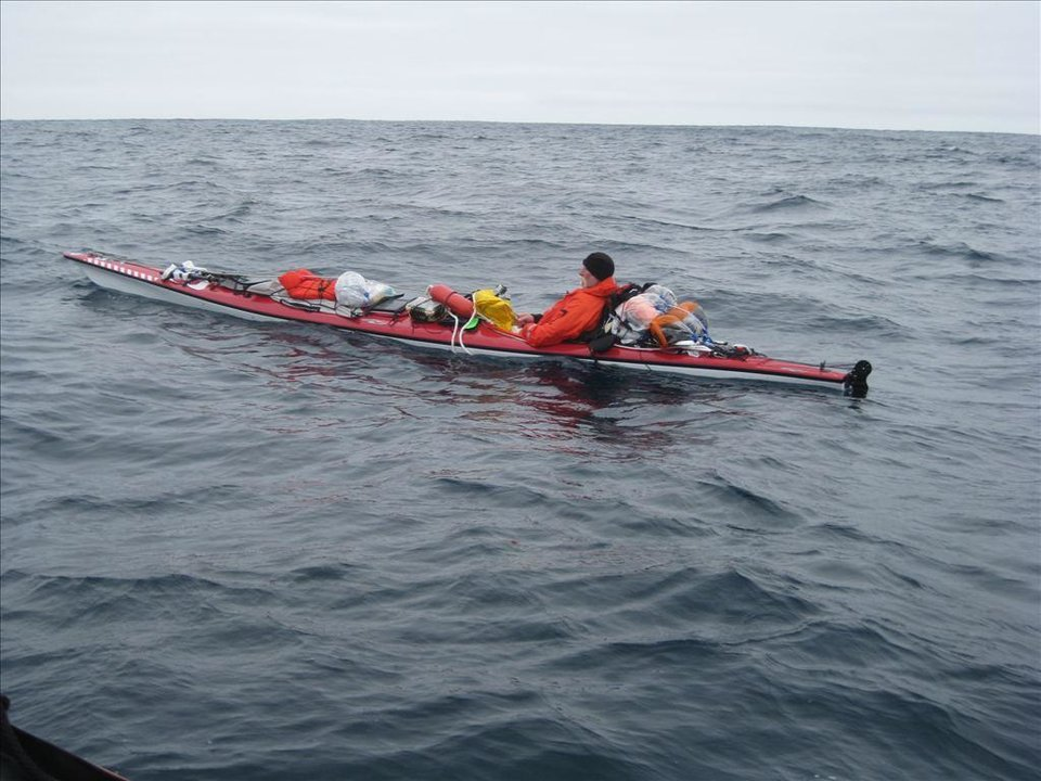 Photo - This Tuesday, June 10, 2014 image provided by the U.S. Coast Guard shows the moments before a rescue of a kayaker about 60 miles southwest of Santa Barbara's Point Conception near southern California. The U.S. Coast Guard says a man is