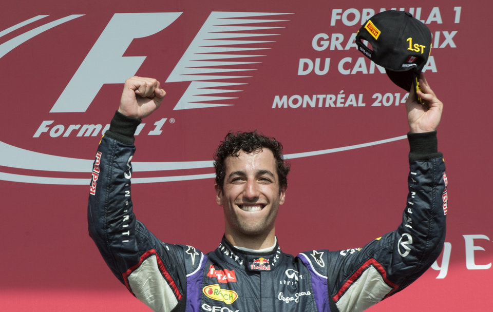 Photo - Red Bull driver Daniel Ricciardo from Australia celebrates his victory at the Canadian Grand Prix, Sunday, June 8, 2014 in Montreal. (AP Photo/The Canadian Press, Paul Chiasson)
