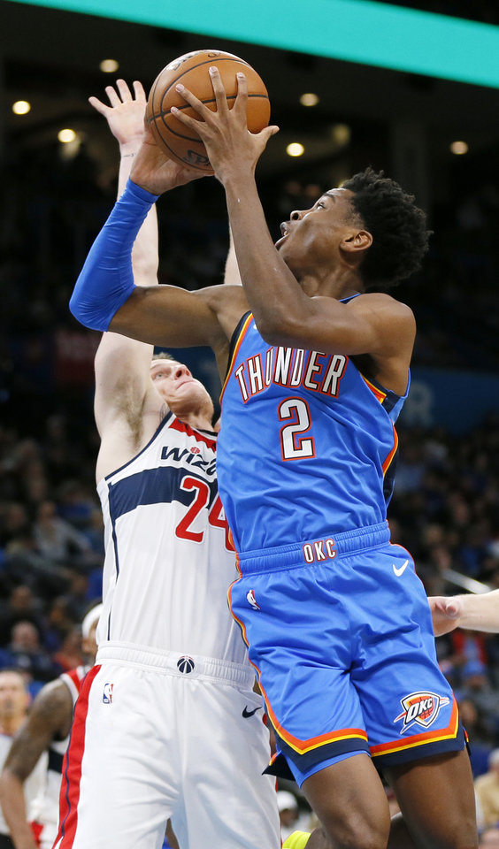 Photo - Oklahoma City's Shai Gilgeous-Alexander (2) shoots against Washington's Garrison Mathews (24) in the second quarter during an NBA basketball game between the Oklahoma City Thunder and the Washington Wizards at Chesapeake Energy Arena in Oklahoma City, Friday, Oct. 25, 2019. [Nate Billings/The Oklahoman]