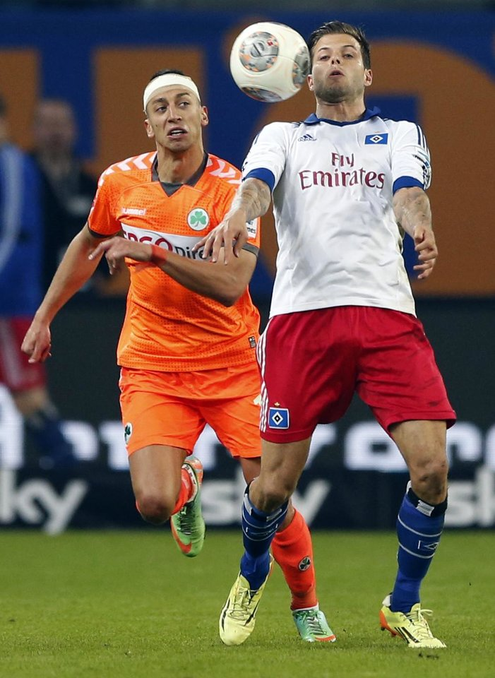 Photo - Hamburg's Dennis Diekmeier, right, and Fuerth's Nikola Djurdjic challenge for the ball during their 1st leg relegation soccer match between Hamburger SV and Greuther Fuerth in Hamburg, Germany, Thursday, May 15, 2014.  (AP Photo/Matthias Schrader)
