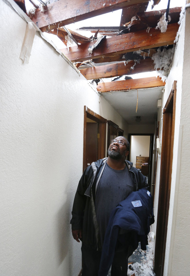 Photo - Saad Mohammed inspects his home on S Robinson in Oklahoma City, Thursday May 23, 2013.Saad's home was destroyed by the massive tornado that hit Monday. Photo By Steve Gooch, The Oklahoman  Steve Gooch