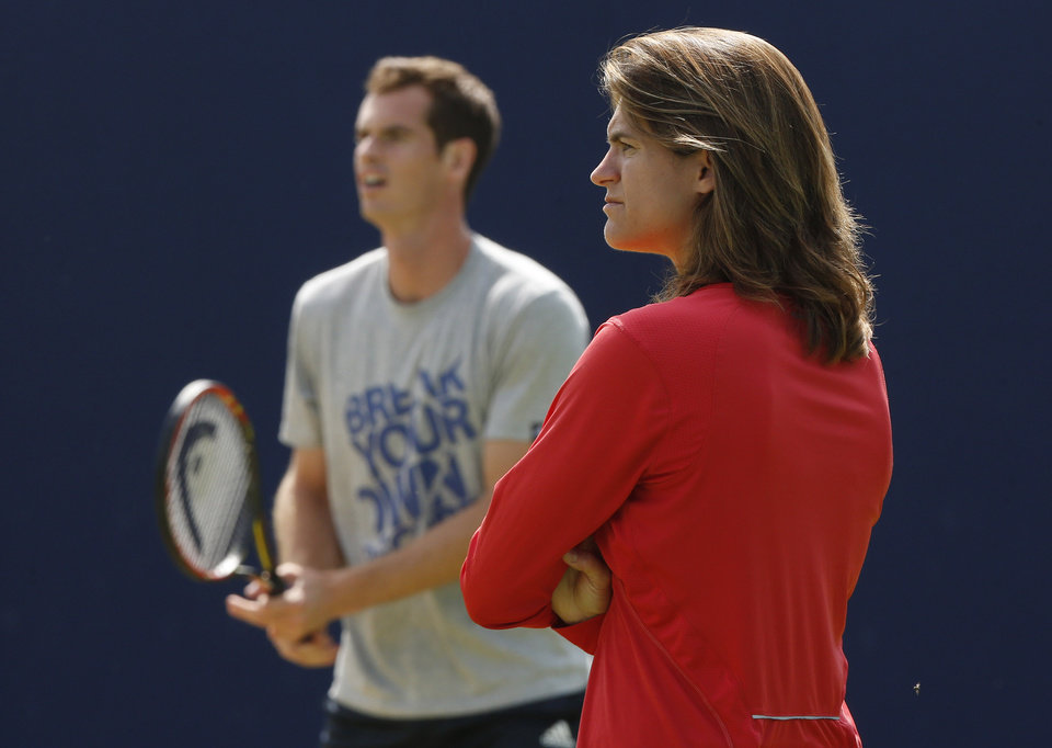 Photo - ADVANCE FOR WEEKEND EDITIONS, JUNE 21-22 - FILE - In this June 12, 2014, file photo, Andy Murray's new coach Amelie Mauresmo, right, watches him  practice during a training session before his Queen's Club grass court championships tennis match in London. The pairing of defending champion Andy Murray and his new coach, Amelie Mauresmo, was quickly dubbed