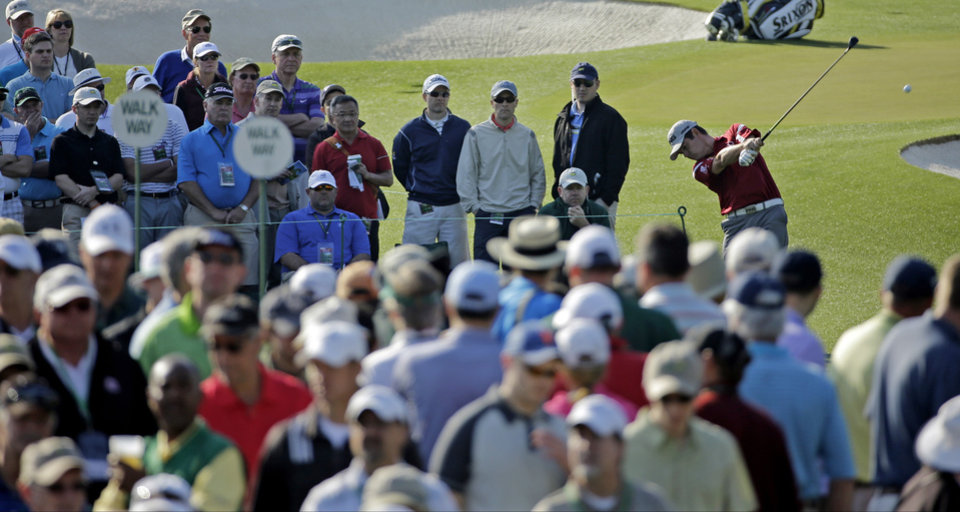 Photo - Louis Oosthuizen, of South Africa, tees off on the third hole during the second round of the Masters golf tournament Friday, April 11, 2014, in Augusta, Ga. (AP Photo/David J. Phillip)