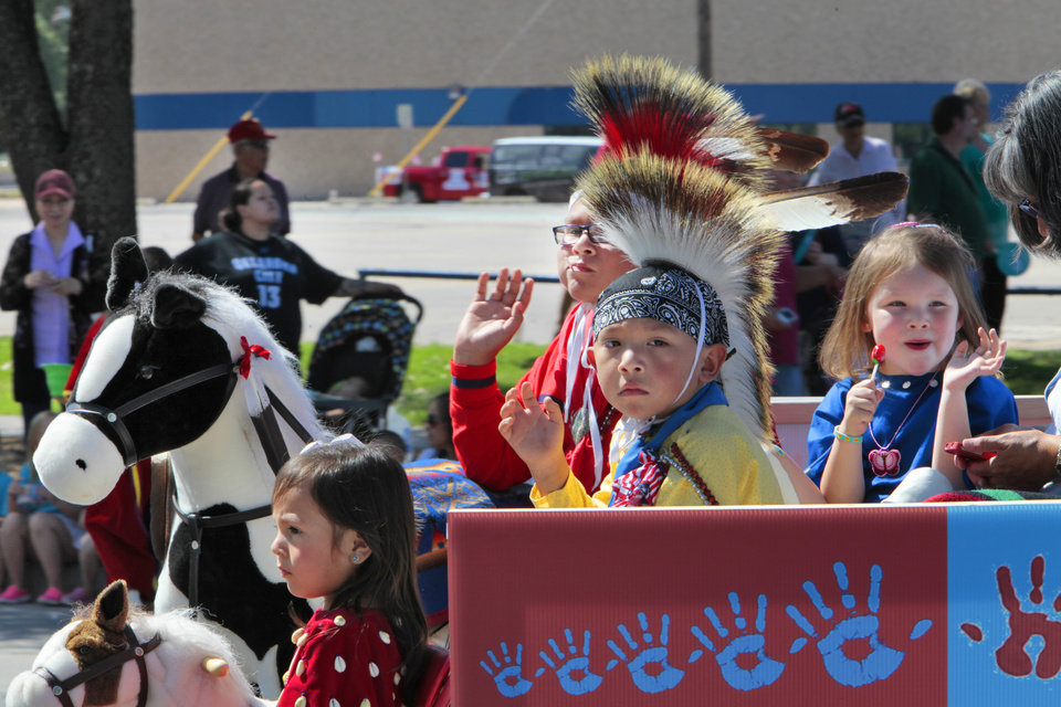 Children on the Kiowa Kids float riding in the Red Earth parade, Friday, June 7, 2013. Photo by David McDaniel, The Oklahoman