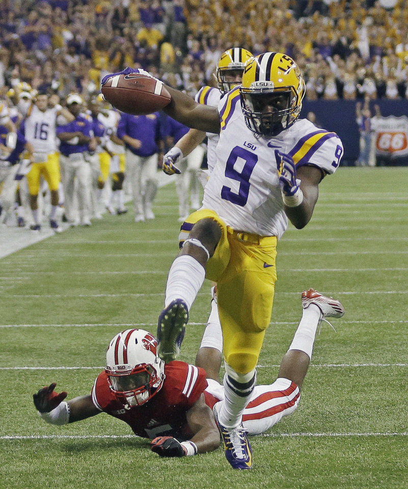 Photo - LSU's John Diarse gets past Wisconsin cornerback Darius Hillary for a 35-yard touchdown reception during the second half of an NCAA college football game Saturday, Aug. 30, 2014, in Houston. (AP Photo/David J. Phillip)
