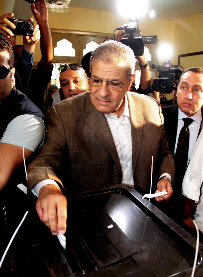 Photo - Egyptian interim Prime Minister Ibrahim Mehlib casts his vote on the first day of the presidential elections inside a polling station in Cairo, Egypt, Monday, May 26, 2014. Egyptians were choosing a new president on Monday in an election likely to be won by retired military chief Field Marshal Abdel-Fattah el-Sissi who nearly a year ago ousted the nation's first freely elected president, the Islamist Mohammed Morsi. El-Sissi is practically assured of a victory in the vote, which is being held over two days, Monday and Tuesday. The only other candidate in the race is leftist politician Hamdeen Sabahi, who finished third in the 2012 presidential election. (AP Photo/Ahmed Gamil)