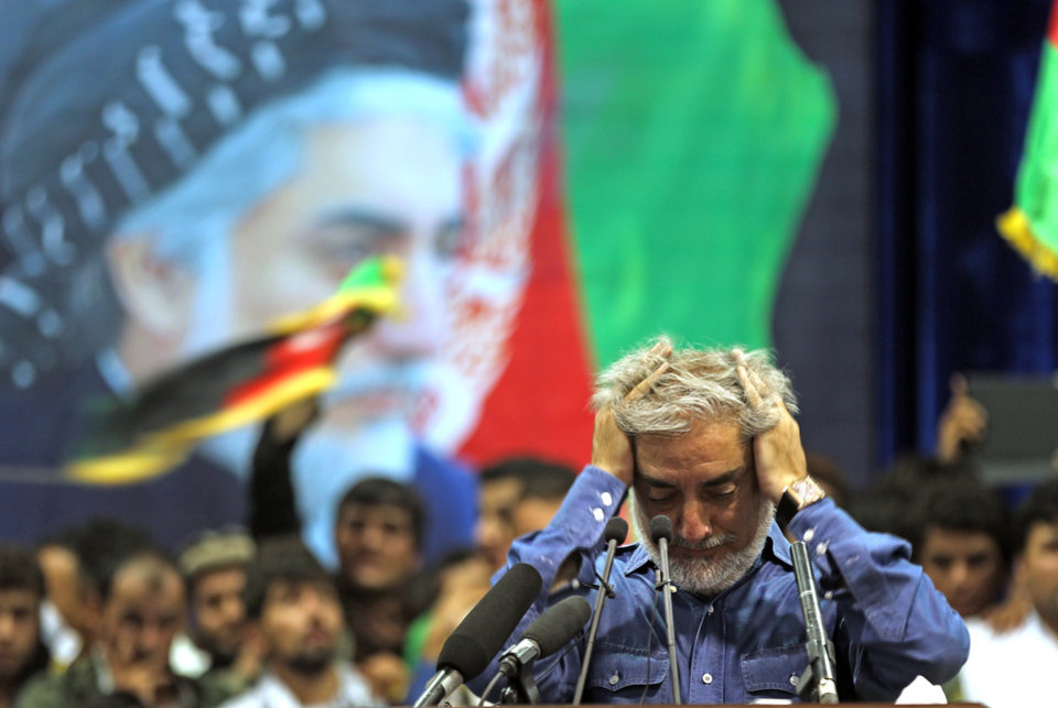 Photo - Afghan presidential candidate Abdullah Abdullah runs his hands through his hair as he pauses in addressing his supporters in Kabul, Afghanistan, Tuesday, July 8, 2014. Abdullah says he received calls from President Barack Obama and U.S. Secretary of State John Kerry after he refused to accept the preliminary result of the vote citing fraud. Abdullah told his supporters the results of the election were fraudulent but asked them to give him a few more days to negotiate. (AP Photo/Massoud Hossaini)