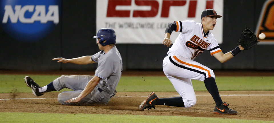 Photo - UC Irvine's Taylor Sparks (25) slides into 3rd base past OSU's Craig McConaughy (40) in the 8th inning during Game 1 of the NCAA baseball Stillwater Super Regional between Oklahoma State and UC Irvine at Allie P. Reynolds Stadium in Stillwater, Okla., Friday, June 6, 2014. Photo by Nate Billings, The Oklahoman