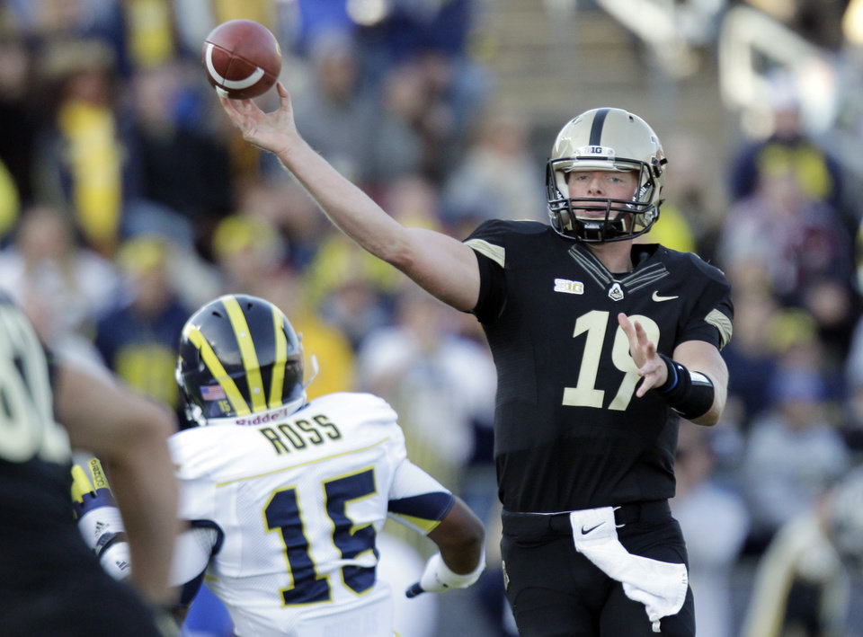 Purdue quarterback Caleb TerBush (19) throws over Michigan linebacker James Ross III during the first half of an NCAA college football game in West Lafayette, Ind., Saturday, Oct. 6, 2012. (AP Photo/Michael Conroy)
