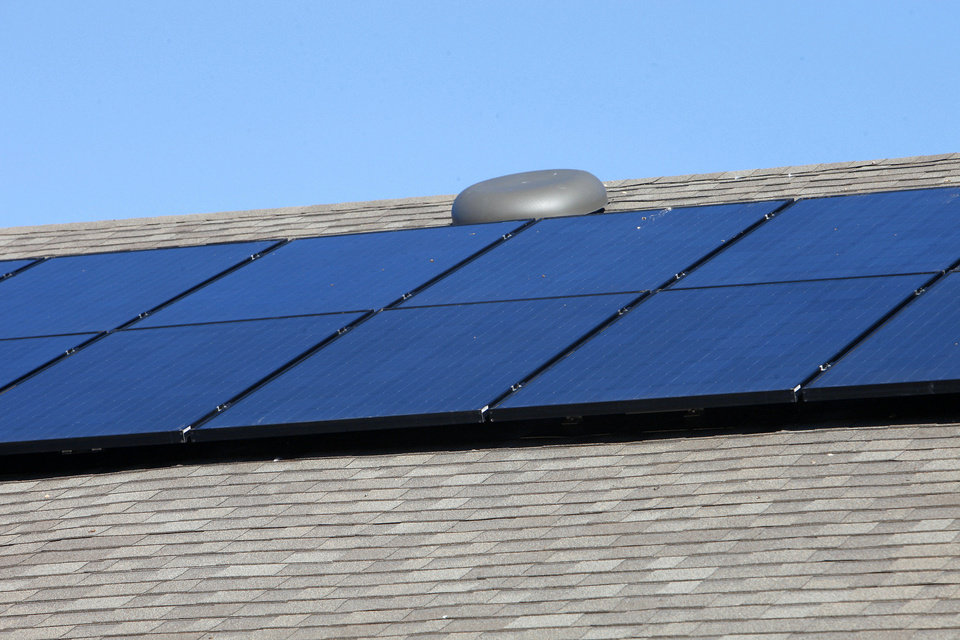 Rooftop solar panels are seen from the backyard of a home at 11424 NW 131 built by Ideal Homes in the Buffalo Grove section of the Village Verde addition northwest of Northwest Expressway and Mustang Road.  Photos by PAUL B. SOUTHERLAND, The Oklahoman