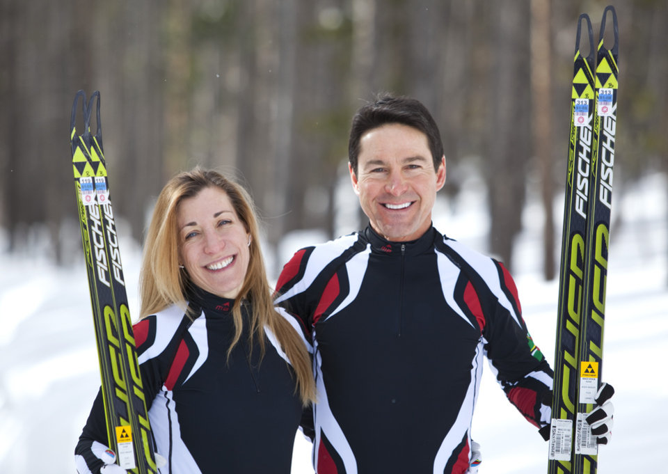 Photo - In this photo taken on Monday, Jan. 27, 2014, cross-country skiers Gary and Angelica di Silvestri pose for a photo at the Yellowstone Club in Big Sky, Mont. The American-born man and his Italian-born wife will be representing the tiny Caribbean island nation of Dominica at the Winter Olympics in Sochi next month. The former finance professionals, granted Dominica citizenship for their philanthropic work on the island, are finishing their training in Montana while hastily arranging their own visas, travel logistics and footing the bill for the entire expedition. (AP Photo/Janie Osborne)