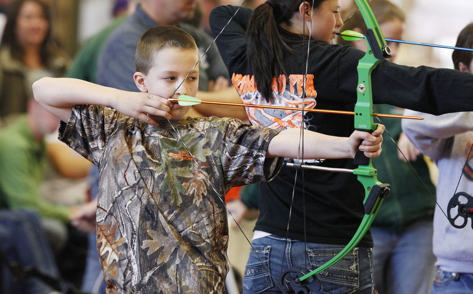 "Sixth-grader Jack Gentry, age 12, from South Rock Creek School in Shawnee, participating in a regional ""Oklahoma Archery In The Schools"" shoot at State Fair Park in Oklahoma City Thursday, Feb. 14, 2013. Photo by Paul B. Southerland, The Oklahoman"