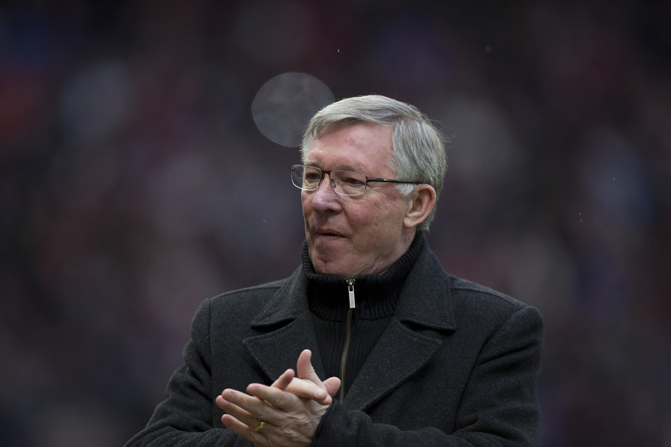 Manchester United's manager Sir Alex Ferguson applauds supporters before his team's English Premier League soccer match against Reading at Old Trafford Stadium, Manchester, England, Saturday March 16, 2013. (AP Photo/Jon Super)