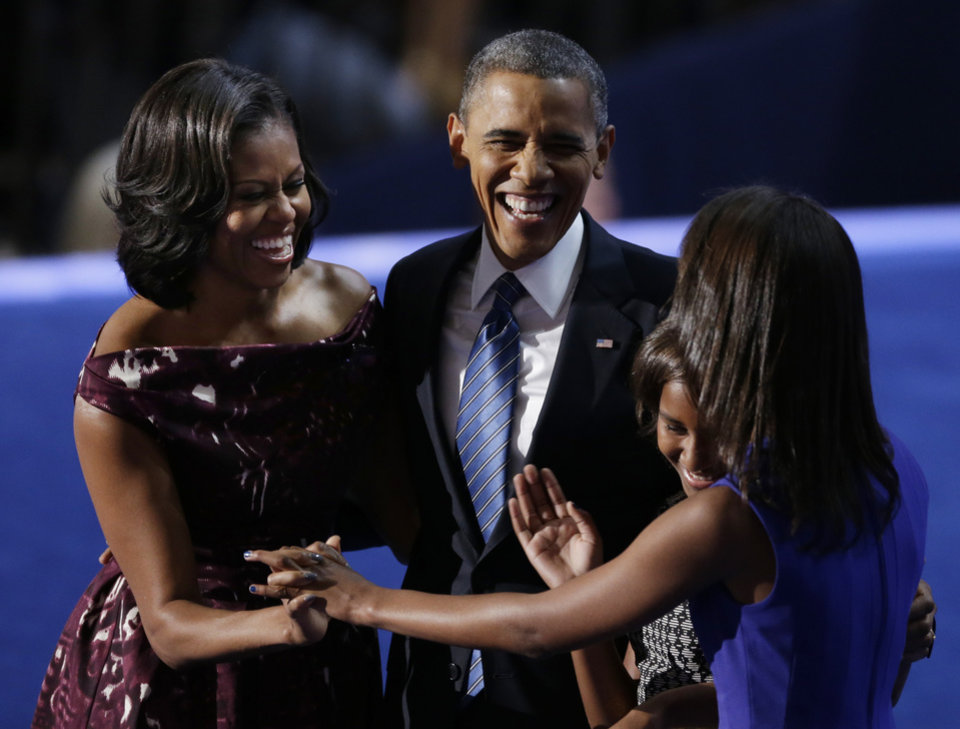 Photo -   President Barack Obama laughs with his wife Michelle and his daughters Malia and Sasha after his speech to the Democratic National Convention in Charlotte, N.C., on Thursday, Sept. 6, 2012. (AP Photo/Lynne Sladky)