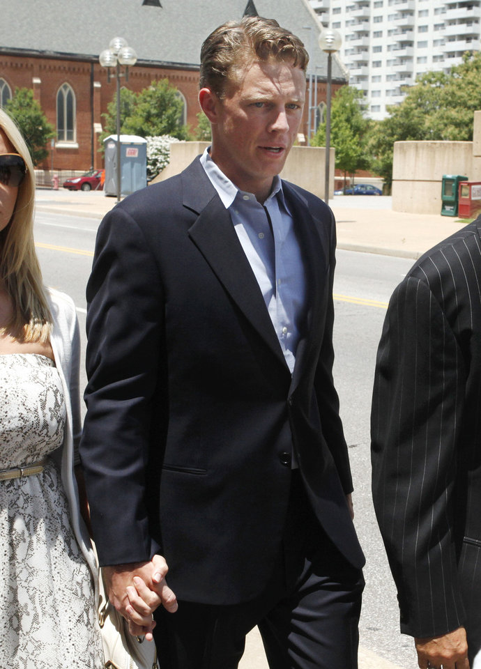 Dryden Mitchell walks to the Oklahoma City federal courthouse Monday for his guilty plea in an illegal gambling case.  <strong>PAUL HELLSTERN - Oklahoman</strong>