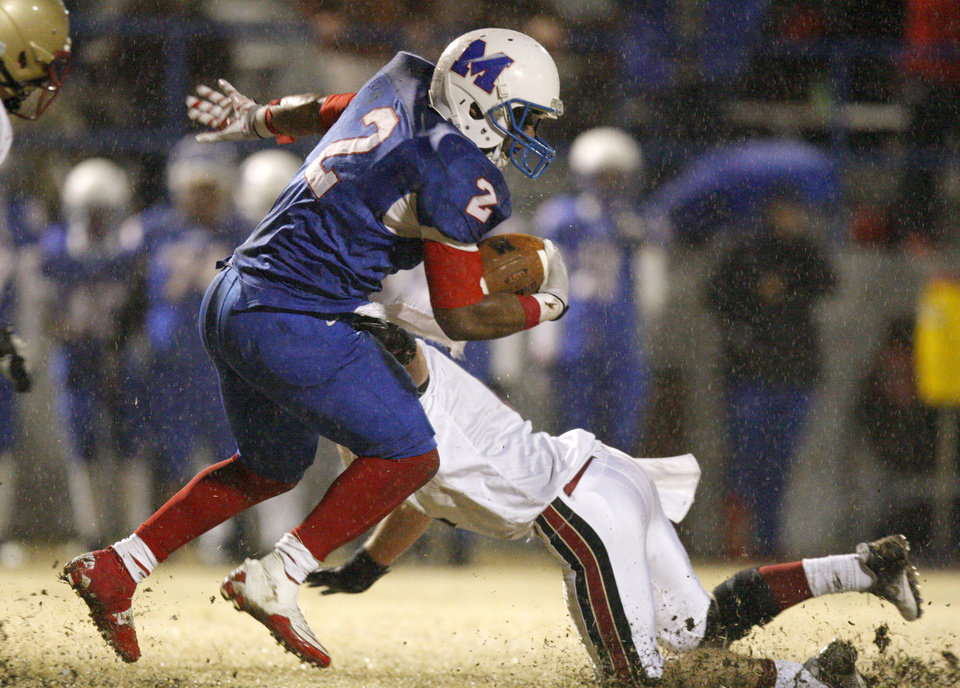 Photo - Millwood's Marc Robinson runs past Lincoln Christian's Andrew Wright during a Class 2A high school football playoff game between Millwood and Lincoln Christian in Oklahoma City, Friday, Nov. 25, 2011. Photo by Bryan Terry, The Oklahoman