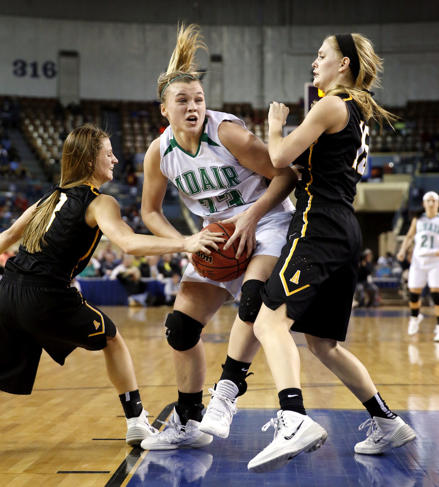 Photo - Adair's Chloe Maritz tries to drive between Bailey Forell and Lora Riley as the Adair Lady Warriors play the Alva Lady Goldbugs in the finals of the State Class 3A Girls Basketball Tournament at the Fairgrounds Arena on Saturday, March 15, 2014, in Oklahoma City, Okla. Photo by Steve Sisney, The Oklahoman