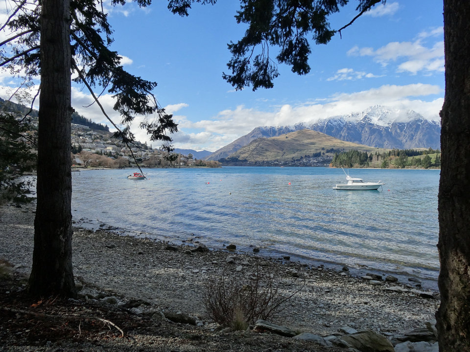 Photo - Small boats sit in calm water in Lake Wakatipu in Queenstown, New Zealand.  PHOTO BY DAMON FONTENOT, THE OKLAHOMAN