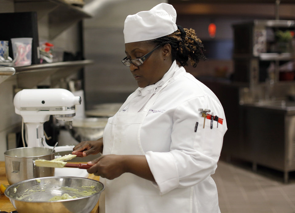 Photo - Shell Woodard prepares food at  Francis Tuttle Technology Center. Photo by Sarah Phipps, The Oklahoman  SARAH PHIPPS - SARAH PHIPPS