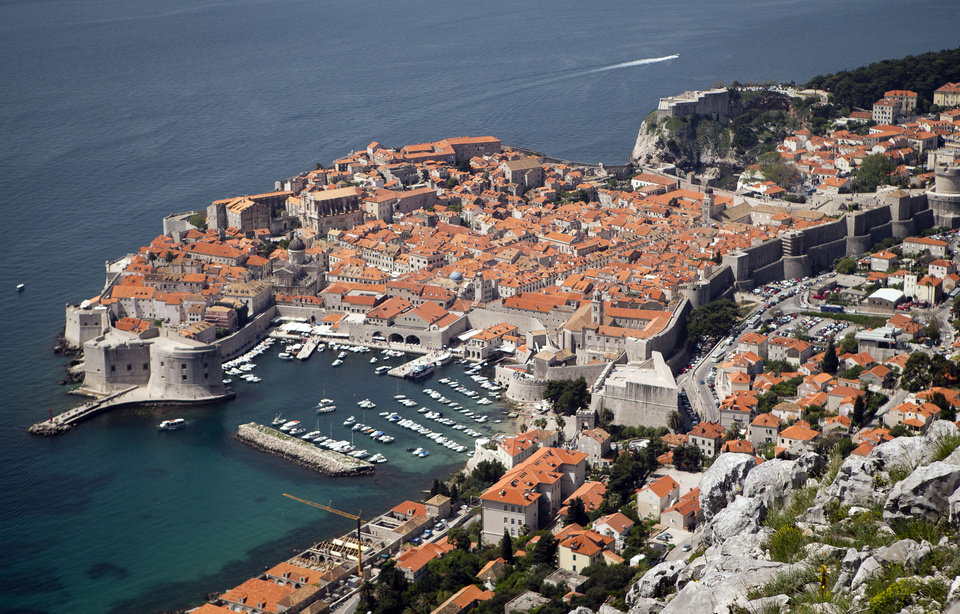 Photo - WITH STORY CROATIA GOLF REFERENDUM - Dubrovnik old town is pictured from Srdj, the hill above the city, Friday, April 26, 2013. The residents of this scenic Croatian Adriatic sea resort will decide hold a referendum on Sunday April 28, 2013, whether to allow the 1.1-billion euros ($1.4 billion) golf park development project on the hill above the city that many claim endangers their ancient city, often dubbed the Pearl of the Adriatic, and the outcome could have serious consequences on the future of foreign investments in Croatia. (AP Photo/Darko Bandic)