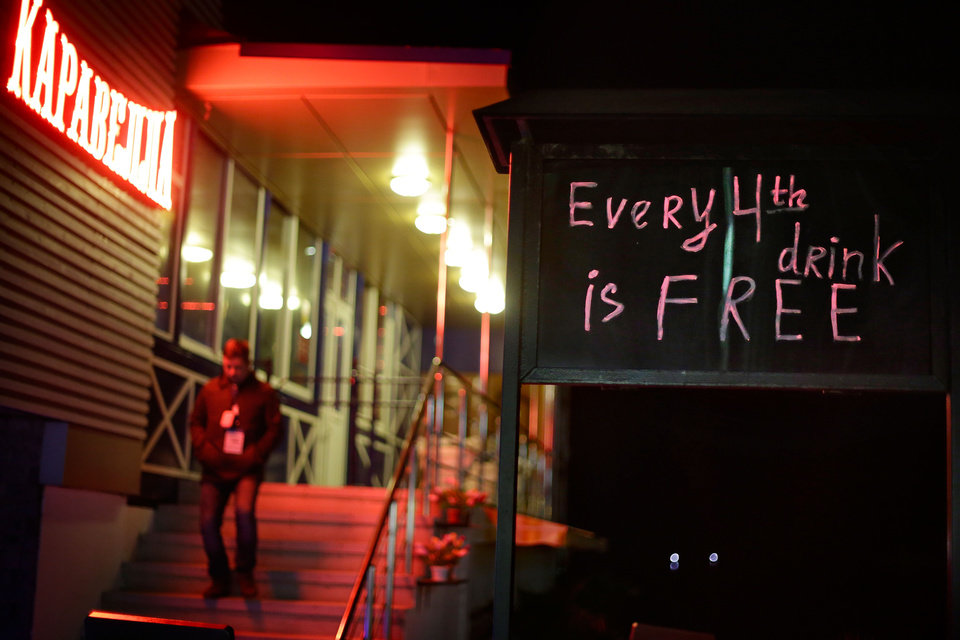 Photo - A bar on the promenade along the Black Sea advertises a drink special, Saturday, Feb. 15, 2014, in central Sochi, Russia, home of the 2014 Winter Olympics. (AP Photo/David Goldman)