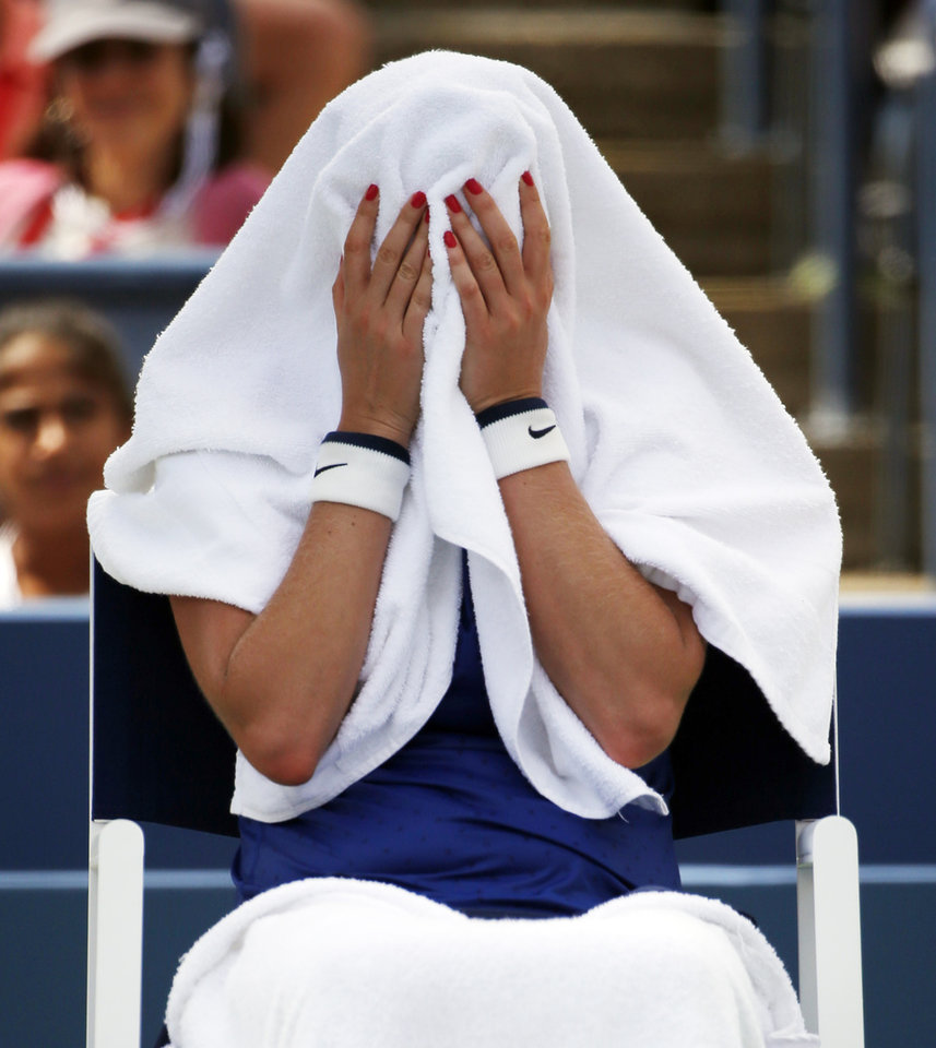 Photo - Petra Kvitova, of the Czech Republic, covers her head with a towel during a break between games against Aleksandra Krunic, of Serbia, during the third round of the 2014 U.S. Open tennis tournament, Saturday, Aug. 30, 2014, in New York. (AP Photo/Kathy Willens)