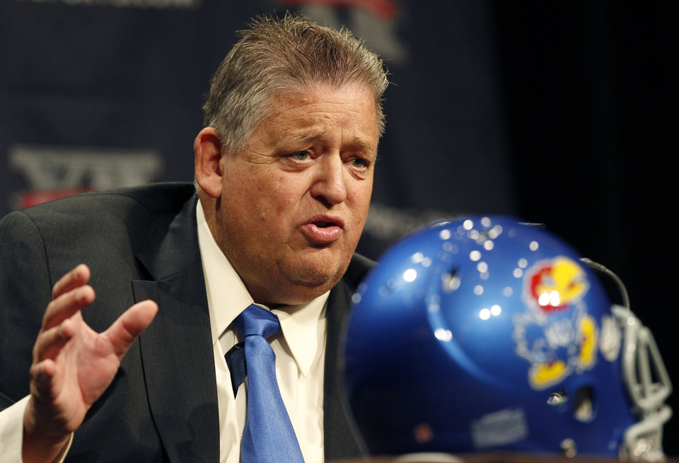 Kansas football coach Charlie Weis answers questions from the media during the Big 12 Conference Football Media Days Monday, July 22, 2013 in Dallas.  (AP Photo/Tim Sharp)