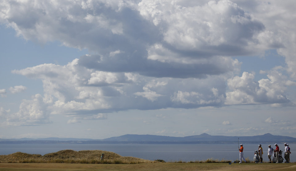 Photo - Richie Ramsay of Scotland plays a shot off the 12th tee during the first round of the British Open Golf Championship at Muirfield, Scotland, Thursday July 18, 2013. (AP Photo/Matt Dunham)