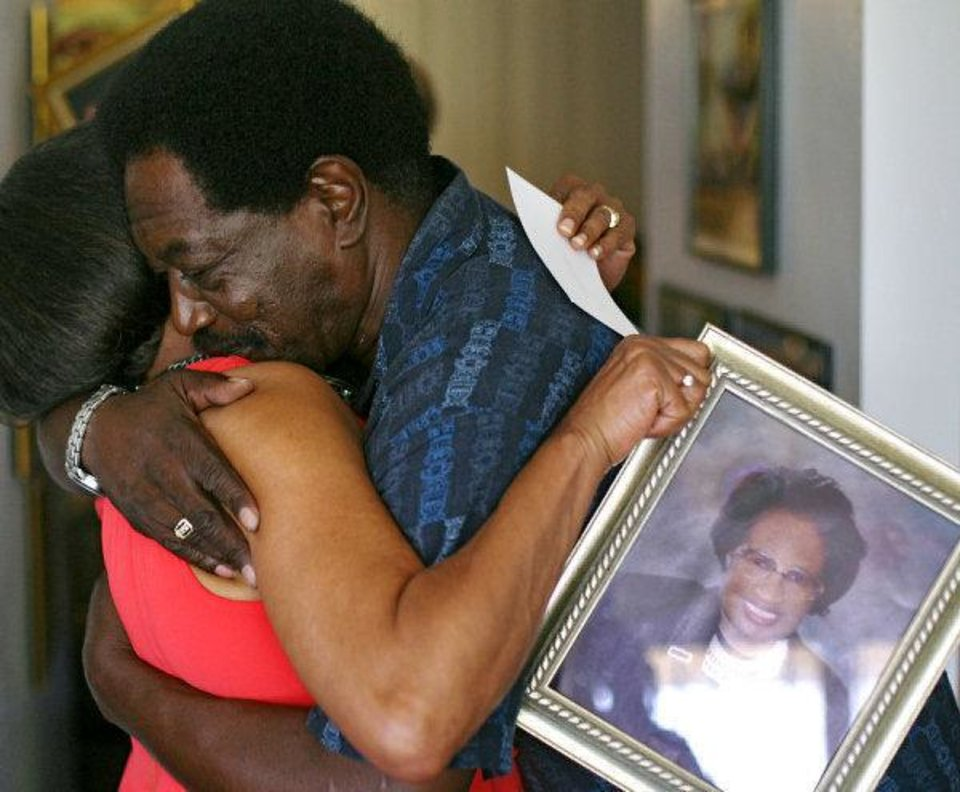 Randell Pyle, a former student of Clara Luper's, hugs Clara's daughter Marilyn Hildreth, as he comes to visit her family at their home in Oklahoma City on Wednesday.  <strong>JOHN CLANTON - JOHN CLANTON</strong>