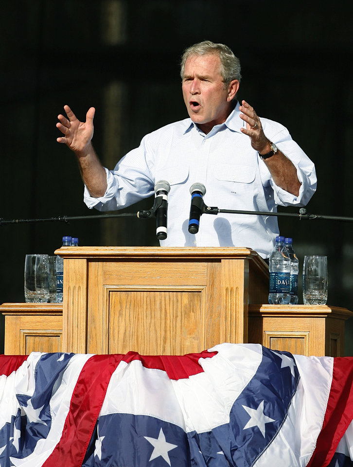 Former President George W. Bush and wife, Laura, were given a warm reception when they arrived at Woodward's July 4th celebration and re-dedication of Crystal Beach Park.  Many of the 6,000 attending wore patriotic clothing and waved American flags. Photo by Jim Beckel, The Oklahoman