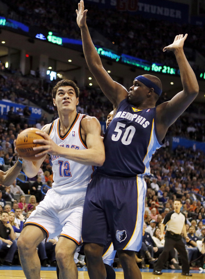 Photo - Oklahoma City's Steven Adams (12) works against Memphis' Zach Randolph (50) during an NBA basketball game between the Memphis Grizzlies and the Oklahoma City Thunder at Chesapeake Energy Arena in Oklahoma City, Friday, Feb. 28, 2014. Photo by Nate Billings, The Oklahoman