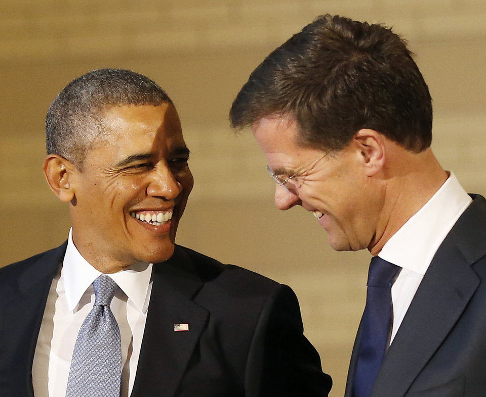 Photo - U.S. President Barack Obama, left, shares a laugh with Dutch Prime Minister Mark Rutte, right, during a visit to the Rijksmuseum in Amsterdam, Netherlands, Monday, March 24, 2014. Obama will attend the two-day Nuclear Security Summit in The Hague. (AP Photo/Frank Augstein)