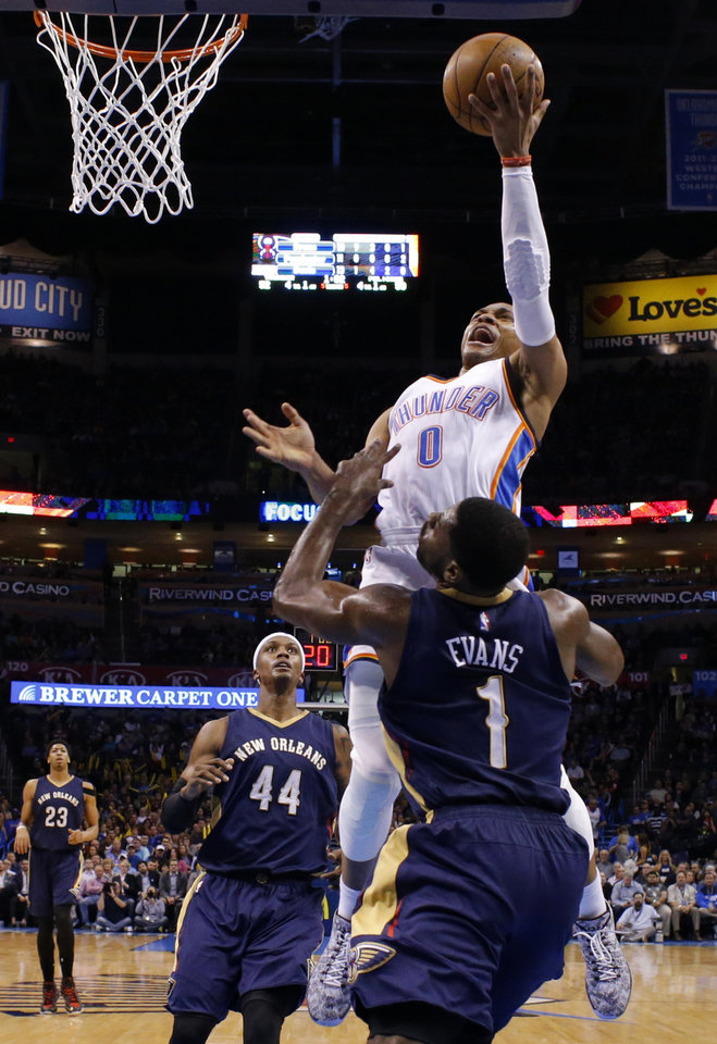 Photo - Oklahoma City's Russell Westbrook (0) goes to the basket between New Orleans' Dante Cunningham (44) and Tyreke Evans (1) during an NBA game between the Oklahoma City Thunder and the New Orleans Pelicans at Chesapeake Energy Arena on Friday, Feb. 6, 2015. Photo by Bryan Terry, The Oklahoman