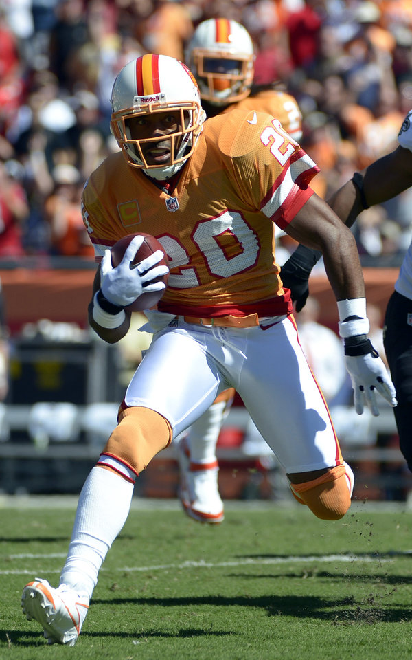Photo -   Tampa Bay Buccaneers free safety Ronde Barber (20) runs with the ball after intercepting a pass from New Orleans Saints quarterback Drew Brees during the first quarter of an NFL football game on Sunday, Oct. 21, 2012, in Tampa, Fla. (AP Photo/ Phelan Ebenhack)