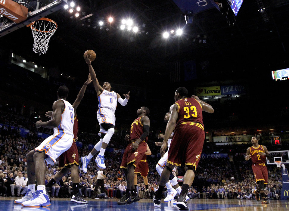 Photo - Oklahoma City's Russell Westbrook (0) shoots a lay up during the NBA basketball game between the Oklahoma City Thunder and the Cleveland Cavaliers at the Chesapeake Energy Arena, Sunday, Nov. 11, 2012. Photo by Sarah Phipps, The Oklahoman