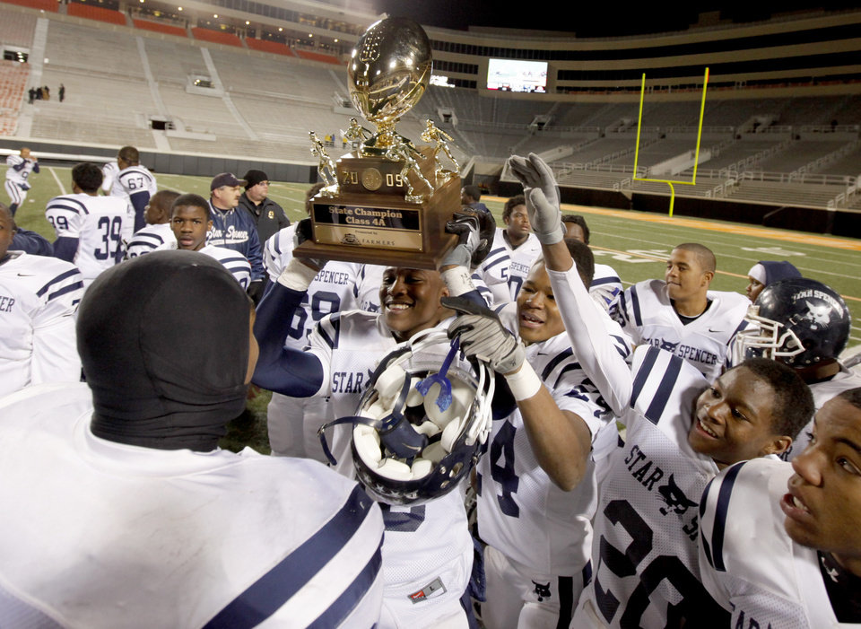 Star Spencer celebrates after winning the Class 4A high school football state championship game betweeen Star Spencer Douglass at Boone Pickens Stadium in Stillwater, Okla., Saturday, December 5, 2009. Photo by Bryan Terry, The Oklahoman