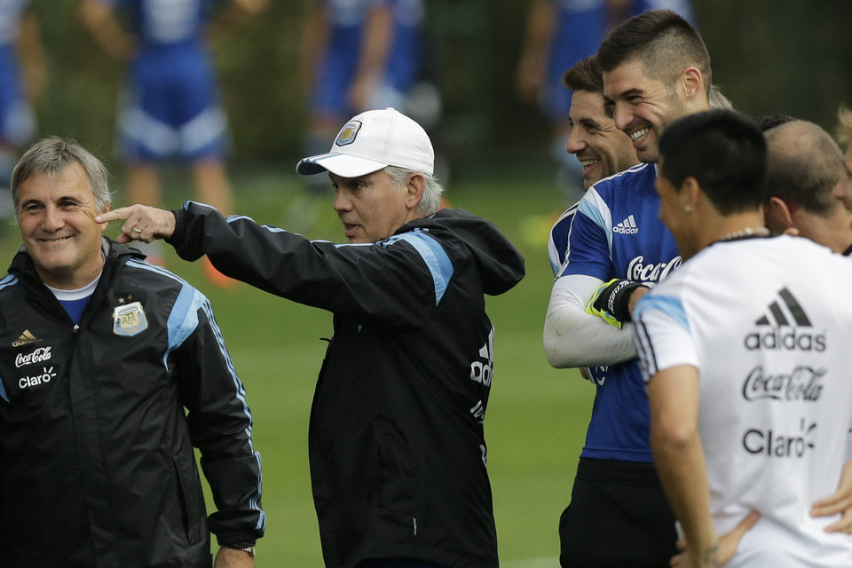 Photo - Argentina's head coach Alejandro Sabella, center, speaks to players during a training session in Vespesiano, near Belo Horizonte, Brazil, Thursday, July 10, 2014. On Sunday, Argentina faces Germany for the World Cup final soccer match in Rio de Janeiro. (AP Photo/Victor R. Caivano)