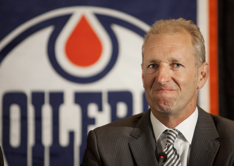 Photo -   Ralph Krueger grimaces during a news conference where he was introduced as the new head coach of the Edmonton Oilers NHL hockey team in Edmonton, Alberta, Wednesday, June 27, 2012. (AP Photo/The Canadian Press, Jason Franson)