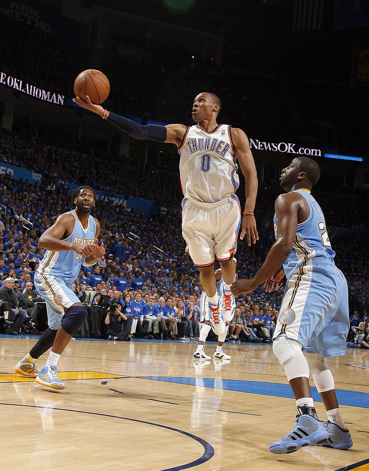 Oklahoma City\'s Russell Westbrook (0) shoots a lay up in front of Denver\'s Raymond Felton (20) during the first round NBA basketball playoff game between the Oklahoma City Thunder and the Denver Nuggets on Wednesday, April 20, 2011, at the Oklahoma City Arena. Photo by Sarah Phipps, The Oklahoman