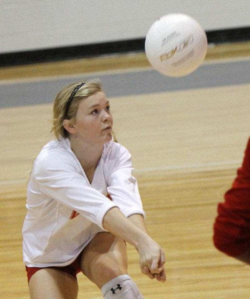 Photo - Cache player Megan Livsey returns a ball as they play Oklahoma Christian in the Class 4A State Volleyball tournament at at Shawnee High School in Shawnee, OK, Friday, Oct. 7, 2011. By Paul Hellstern, The Oklahoman ORG XMIT: KOD