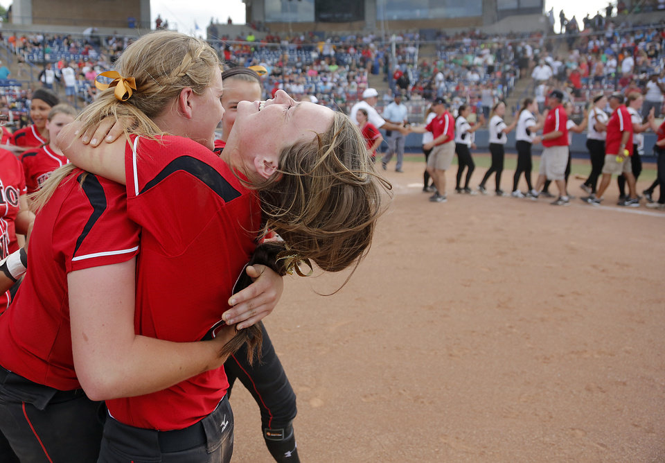 Tulsa Union's Kelsey Goodwin, left, and Madison McGraw celebrate the win over Broken Arrow in the Class 6A Oklahoma State High School Slow Pitch Softball Championship at ASA Hall of Fame Stadium in Oklahoma City, Wednesday, May 1, 2013. Photo by Chris Landsberger, The Oklahoman