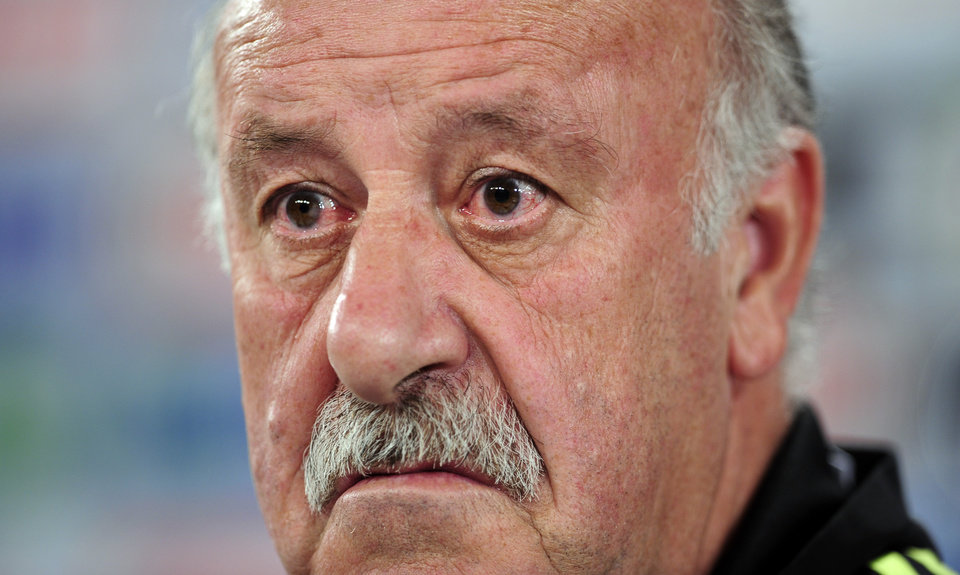Photo - Spain's head coach Vicente del Bosque, listens, during a press conference at the Atletico Paranaense training center, in Curitiba, Brazil, Friday, June 20, 2014. Spain will play in group B of the Brazil 2014 World Cup. (AP Photo/Manu Fernandez)